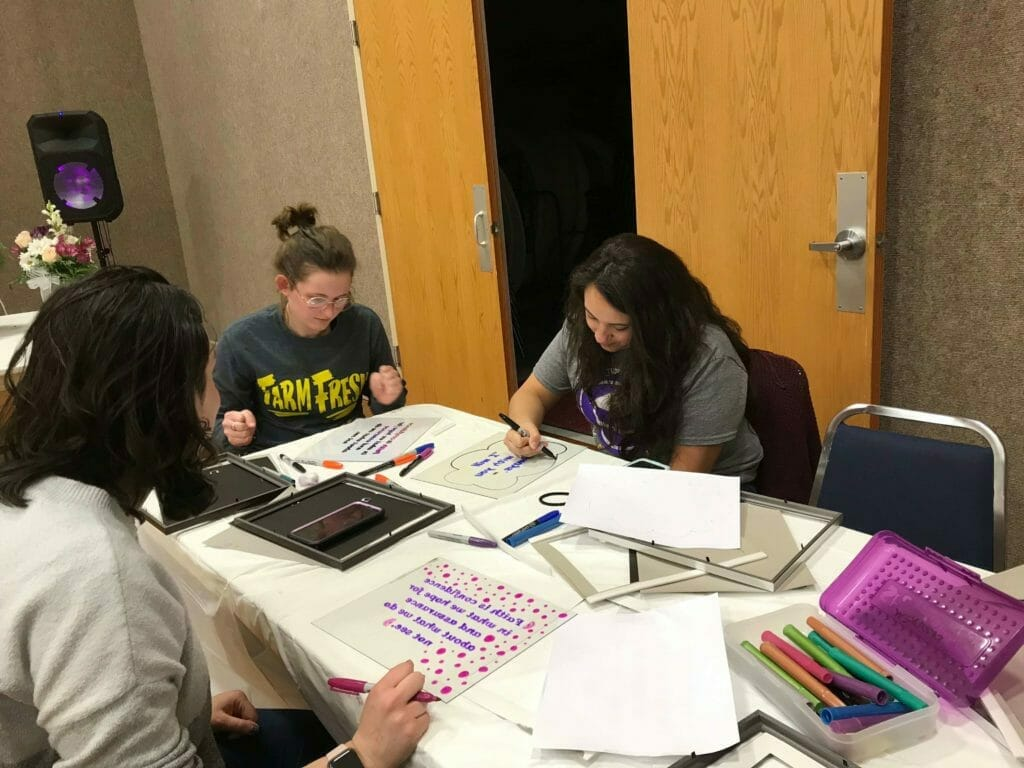 College Women created word art pictures using a reverse painting process.