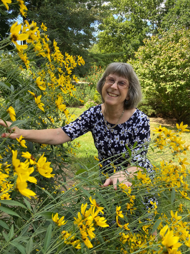 Karen Wingate with yellow flowers